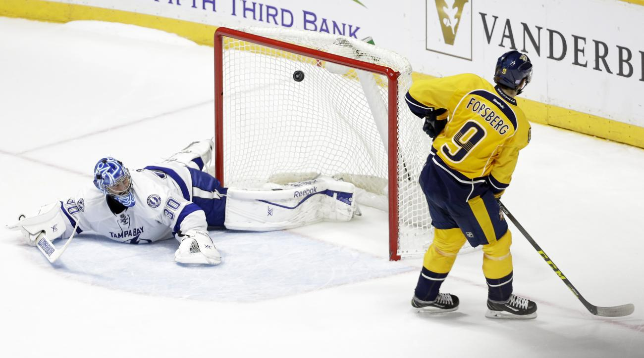 Nashville Predators center Filip Forsberg (9), of Sweden, scores a goal against Tampa Bay Lightning goalie Ben Bishop (30) during a shootout in an NHL hockey game Tuesday, Oct. 20, 2015, in Nashville, Tenn. The goal gave the Predators a 5-4 win. (AP Photo