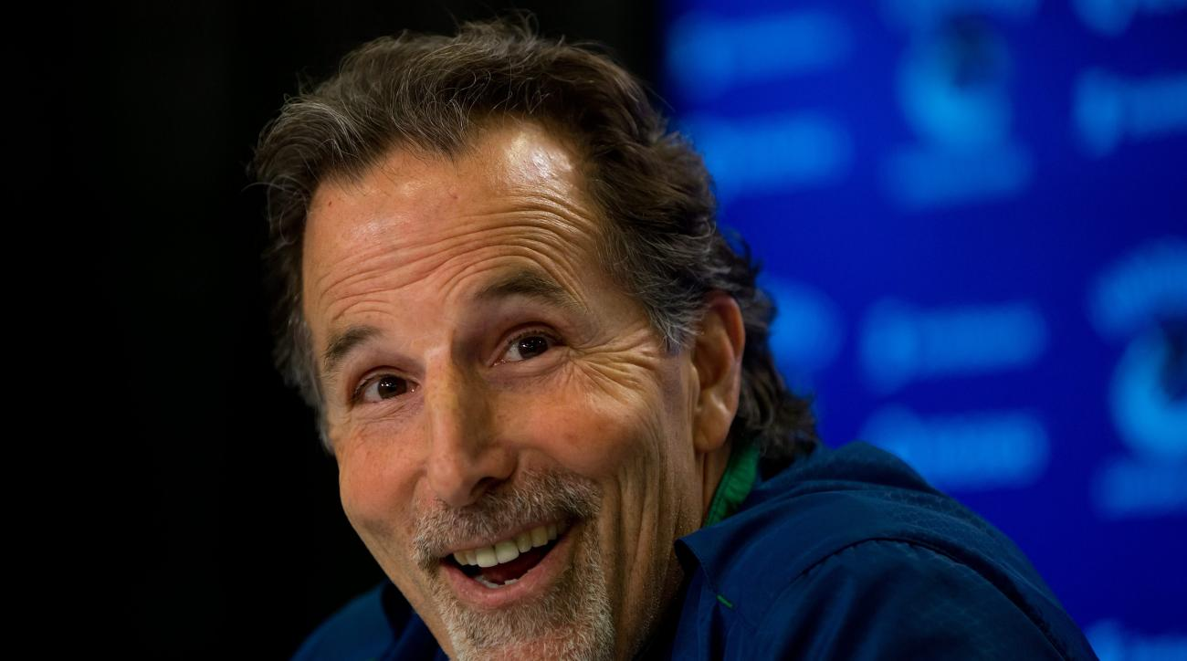 FILE - In this April 14, 2014, file photo, then-Vancouver Canucks' head coach John Tortorella laughs after a reporter mistakenly called him Mike during an end of season news conference in Vancouver, British Columbia. After an 0-7 start, the Blue jackets h