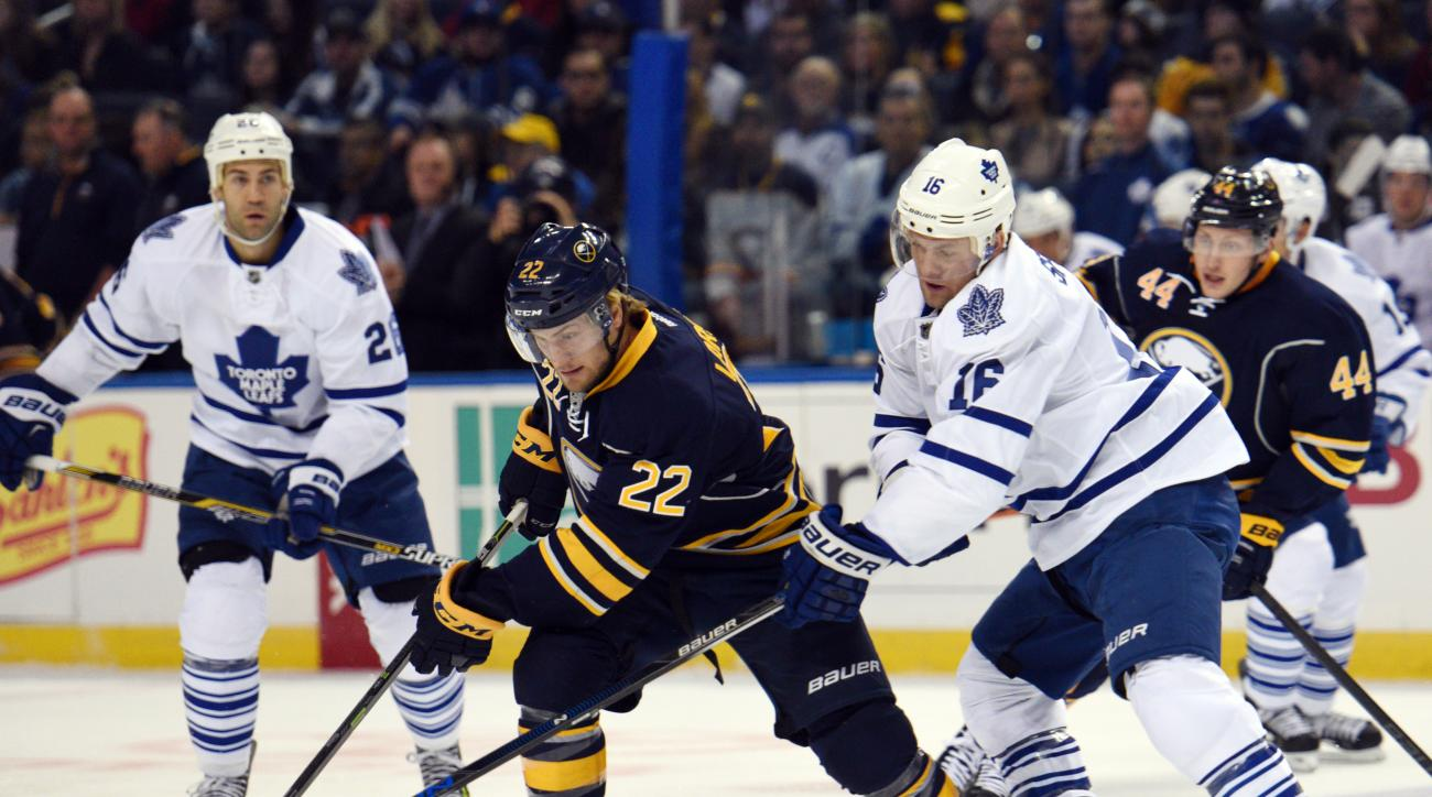 Buffalo Sabres left winger Johan Larsson (22), of Sweden, skates away from Toronto Maple Leafs center Nick Spaling (16) during the first period of an NHL hockey game, Wednesday, Oct. 21, 2015 in Buffalo, N.Y. (AP Photo/Gary Wiepert)