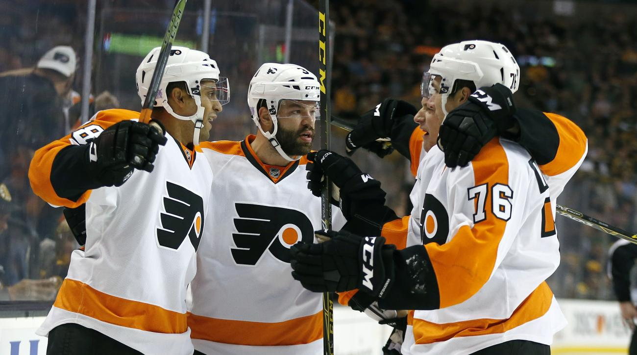 Philadelphia Flyers' Pierre-Edouard Bellemare (78) celebrates his goal with teammates Radko Gudas (3) and Chris VandeVelde (76) during the first period of an NHL hockey game against the Boston Bruins in Boston, Wednesday, Oct. 21, 2015. (AP Photo/Michael