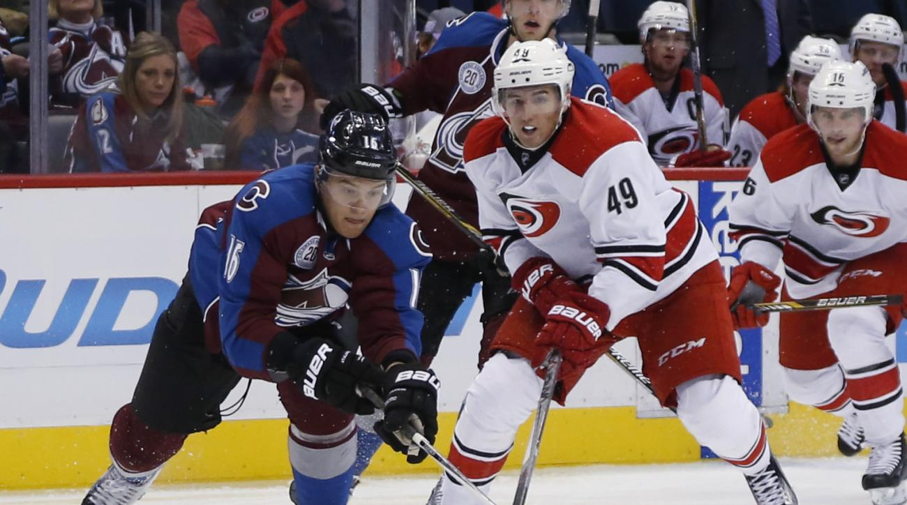 Colorado Avalanche defenseman Nikita Zadorov, left, of Russia, vies for control of the puck with Carolina Hurricanes center Victor Rask, of Sweden, during the second period of an NHL hockey game Wednesday, Oct. 21, 2015, in Denver. (AP Photo/David Zalubow
