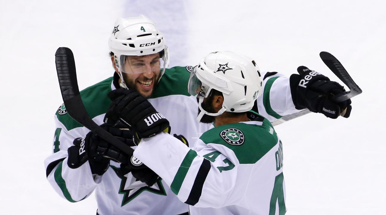 Dallas Stars' Johnny Oduya (47) celebrates his goal with teammate Jason Demers (4) during the first period of an NHL hockey game against the Pittsburgh Penguins in Pittsburgh, Thursday, Oct. 22, 2015. (AP Photo/Gene J. Puskar)