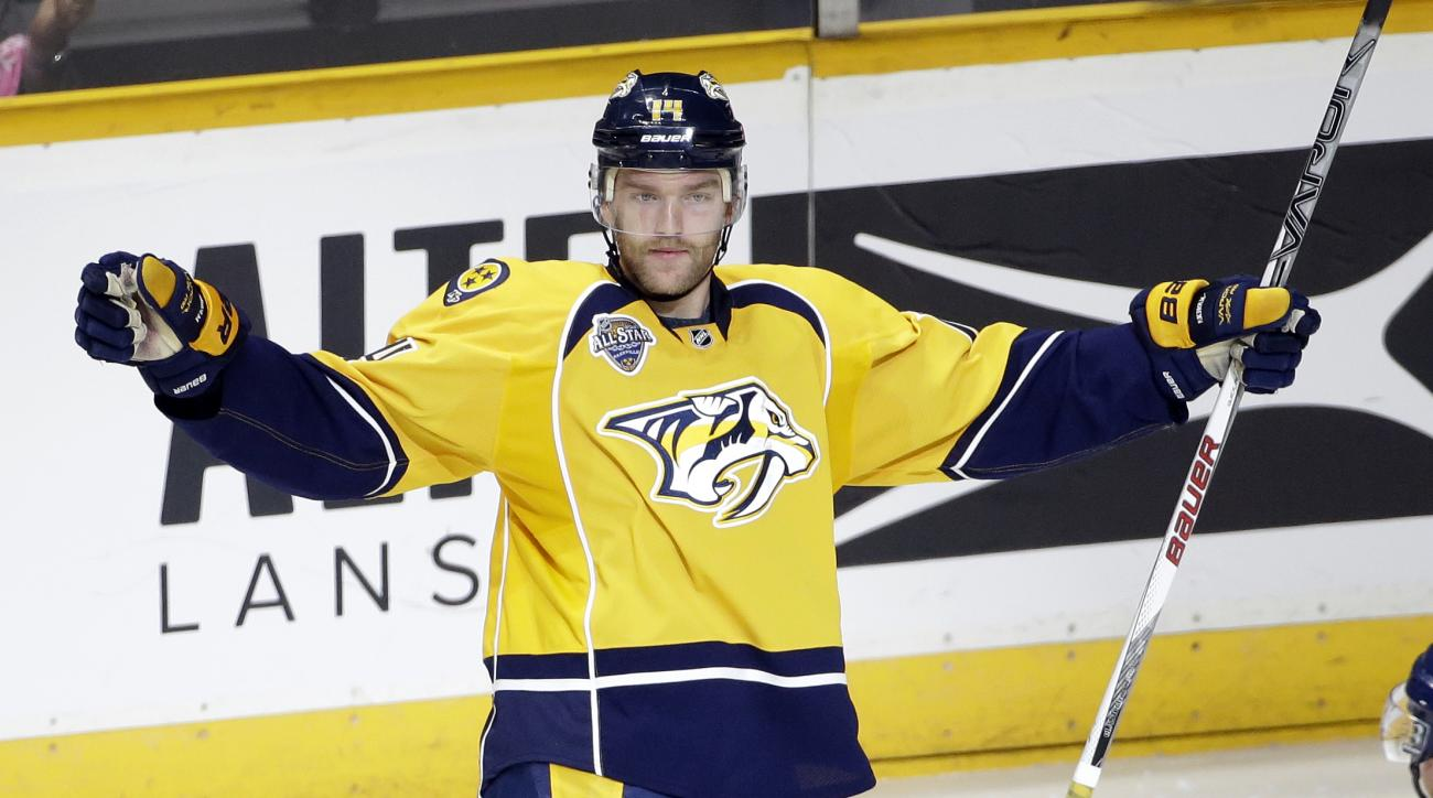 Nashville Predators defenseman Mattias Ekholm, of Sweden, celebrates after scoring a goal against the Anaheim Ducks in the third period of an NHL hockey game Thursday, Oct. 22, 2015, in Nashville, Tenn. (AP Photo/Mark Humphrey)