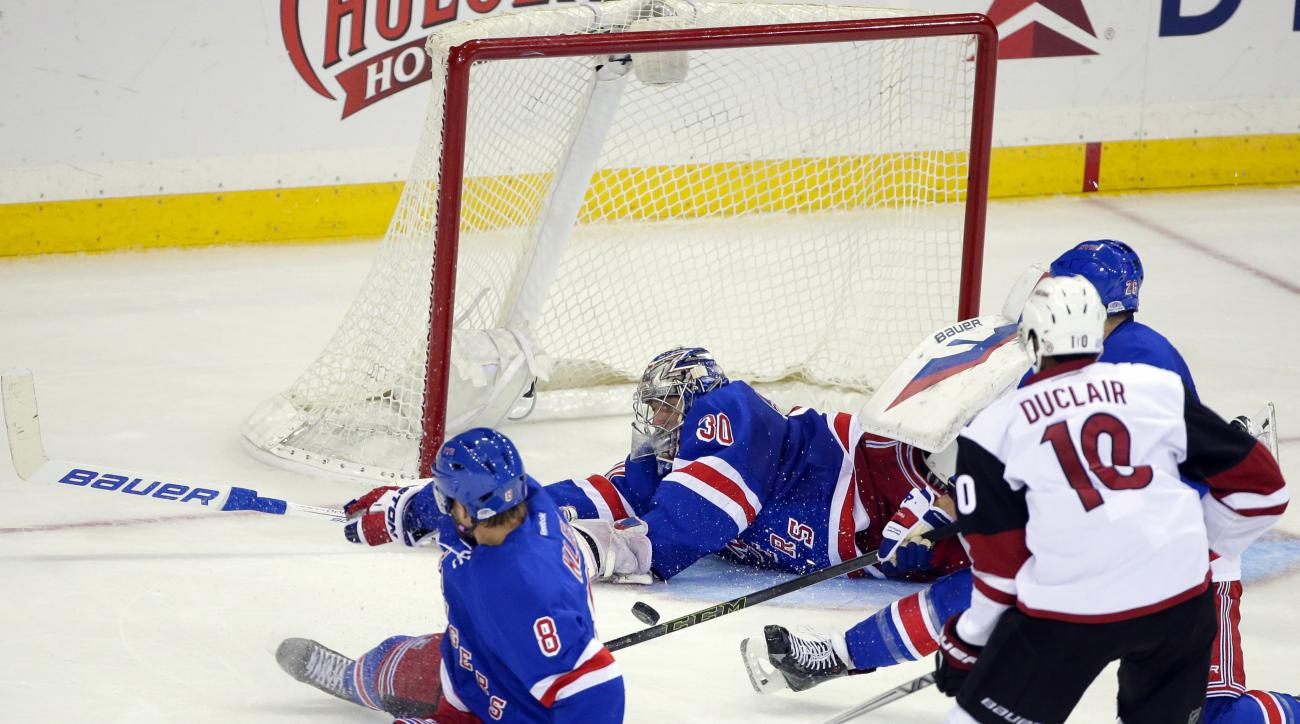 New York Rangers goalie Henrik Lundqvist (30) stops a shot on goal by Arizona Coyotes' Anthony Duclair (10) during the third period of an NHL hockey game Thursday, Oct. 22, 2015, in New York. The Rangers won 4-1. (AP Photo/Frank Franklin II)