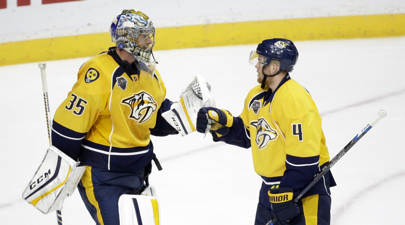 Nashville Predators defenseman Ryan Ellis (4) congratulates goalie Pekka Rinne (35), of Finland, after defeating the Anaheim Ducks 5-1 in an NHL hockey game Thursday, Oct. 22, 2015, in Nashville, Tenn. (AP Photo/Mark Humphrey)