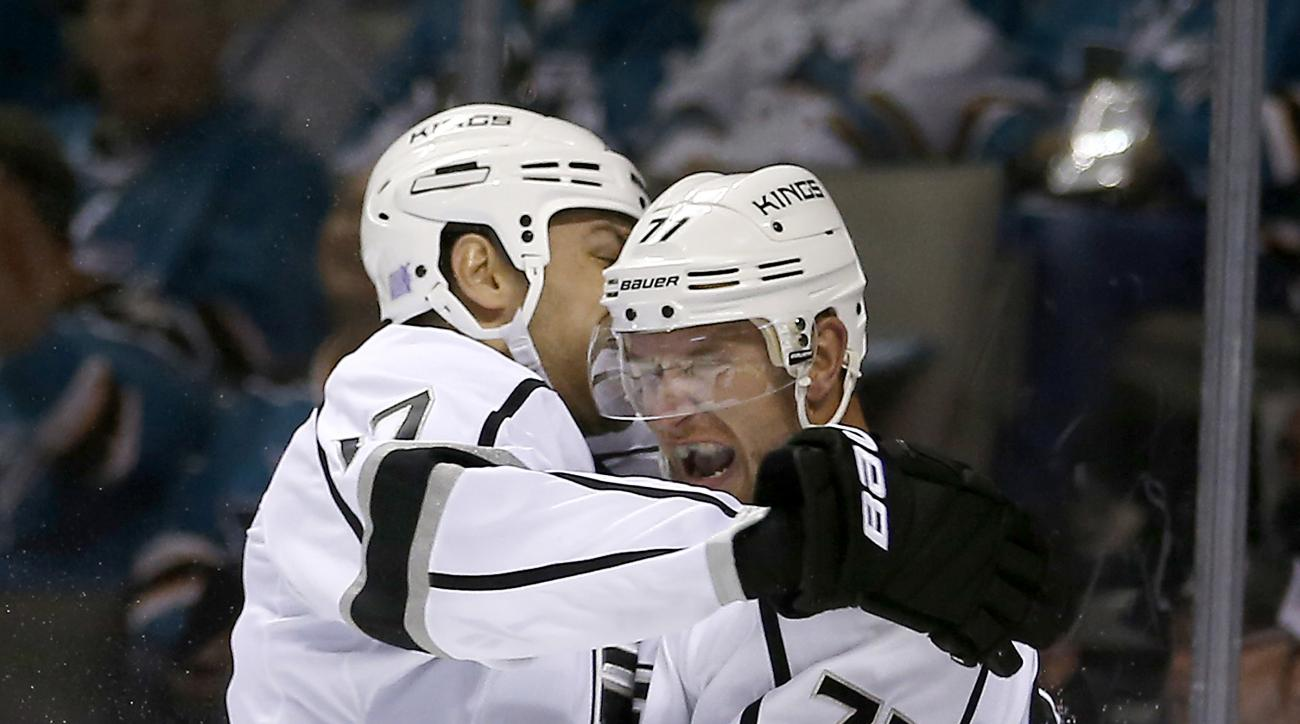 Los Angeles Kings center Jeff Carter (77) celebrates with teammate Milan Lucic after scoring a goal against the San Jose Sharks during the second period of an NHL hockey game Thursday, Oct. 22, 2015, in San Jose, Calif. (AP Photo/Tony Avelar)