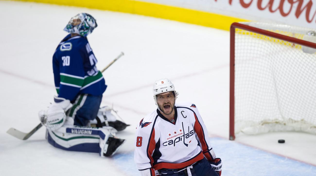 Washington Capitals' Alex Ovechkin, right, of Russia, celebrates after scoring against Vancouver Canucks goalie Ryan Miller during the third period of an NHL hockey game in Vancouver, British Columbia, on Thursday, Oct. 22, 2015. The Capitals won 3-2. (Da