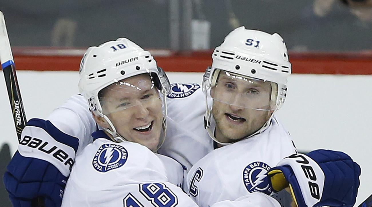 Tampa Bay Lightning's Ondrej Palat (18) and Steven Stamkos (91) celebrate Palat's winning goal against the Winnipeg Jets during overtime of an NHL hockey game Friday, Oct. 23, 2015, in Winnipeg, Manitoba. (John Woods/The Canadian Press via AP) MANDATORY C
