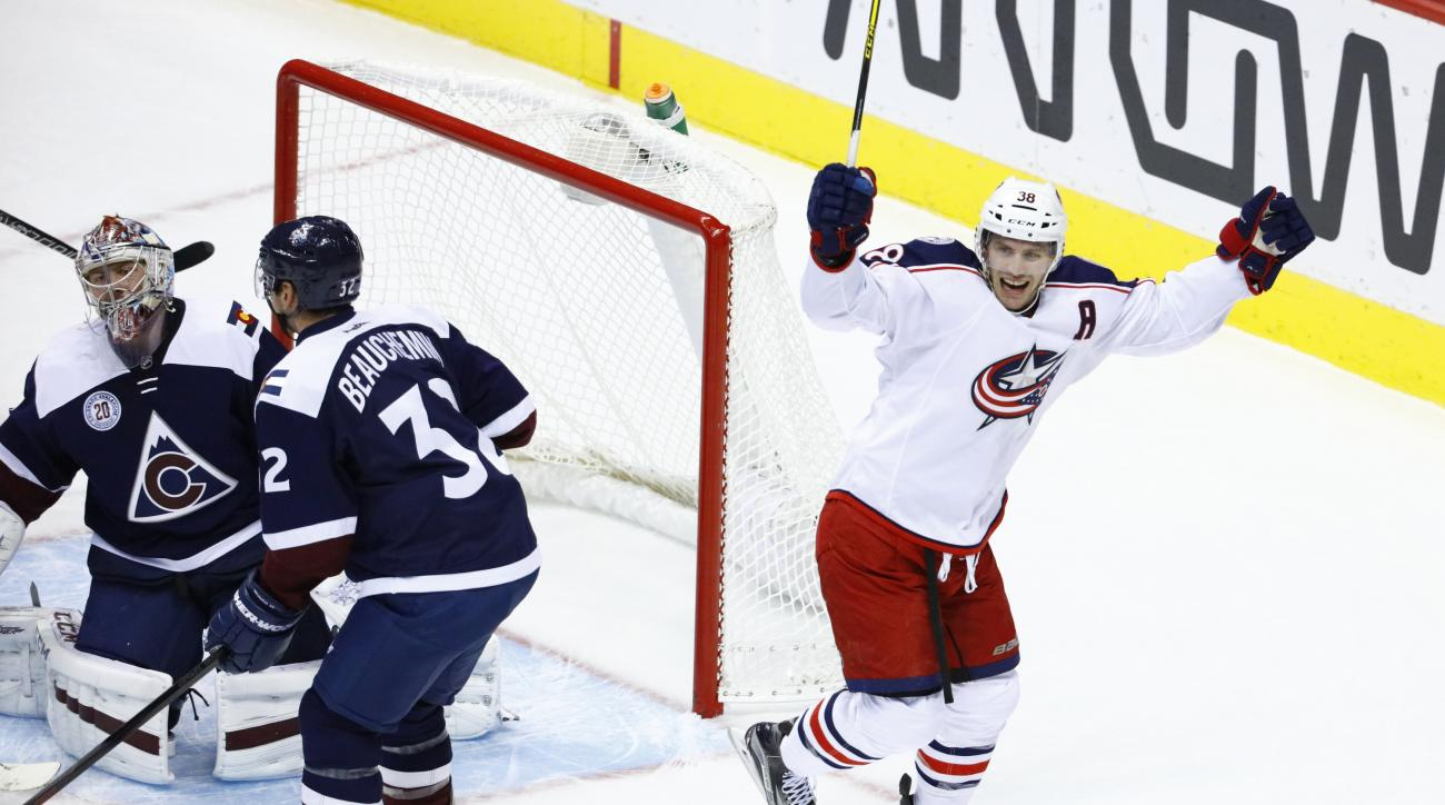 Columbus Blue Jackets center Boone Jenner (38) celebrates a goal by teammate David Savard against Colorado Avalanche goalie Semyon Varlamov (1) during the first period of an NHL hockey game Saturday, Oct. 24, 2015, in Denver. (AP Photo/Jack Dempsey)