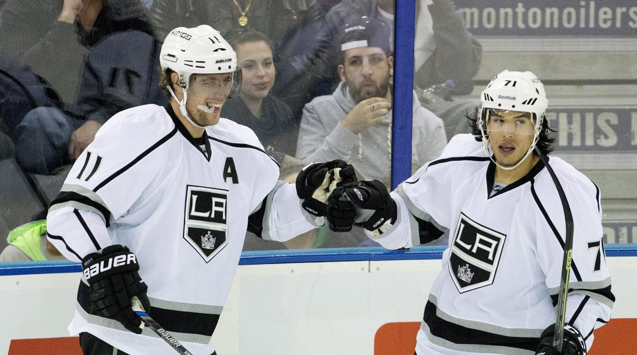 Los Angeles Kings Anze Kopitar (11) and Jordan Nolan (71) celebrate a goal against the Edmonton Oilers during second period NHL action in Edmonton, Alberta, Sunday, Oct. 25, 2015. (Jason Franson/The Canadian Press via AP)