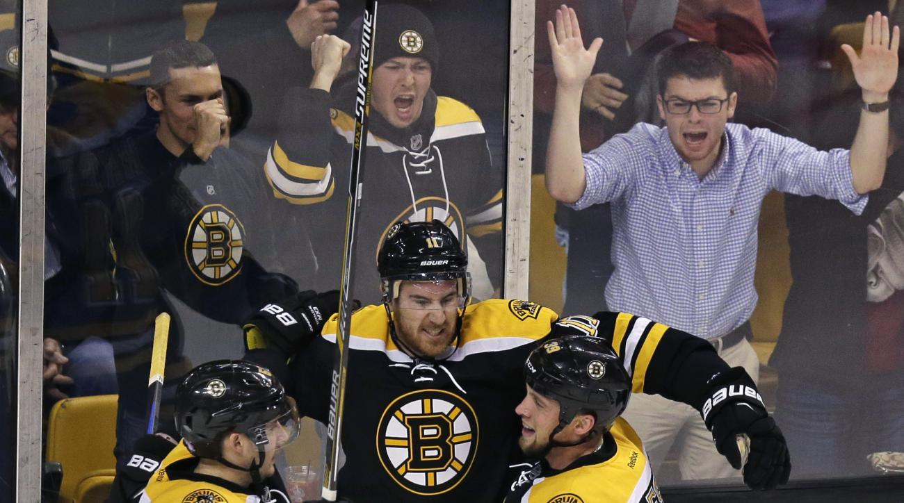 Boston Bruins right wing Jimmy Hayes, center, celebrates after his goal during the second period of an NHL hockey game against the Arizona Coyotes in Boston, Tuesday, Oct. 27, 2015. (AP Photo/Charles Krupa)