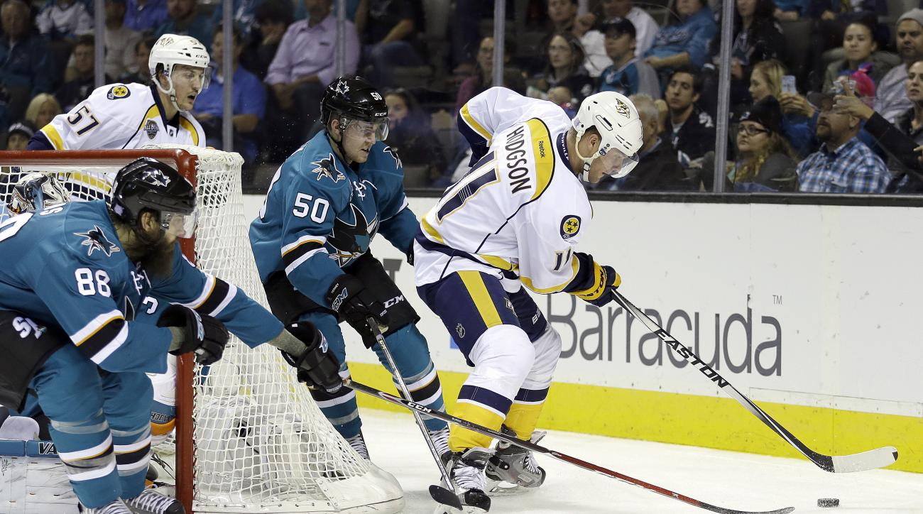 Nashville Predators' Cody Hodgson, right, moves the puck away from San Jose Sharks' Brent Burns (88) and Chris Tierney (50) during the second period of an NHL hockey game Wednesday, Oct. 28, 2015, in San Jose, Calif. (AP Photo/Ben Margot)