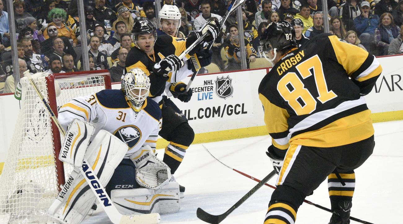 Buffalo Sabres goalie Chad Johnson (31) makes a save against Pittsburgh Penguins center Sidney Crosby (87) during the second period of an NHL hockey game on Thursday, Oct. 29, 2015, in Pittsburgh. (AP Photo/Don Wright)