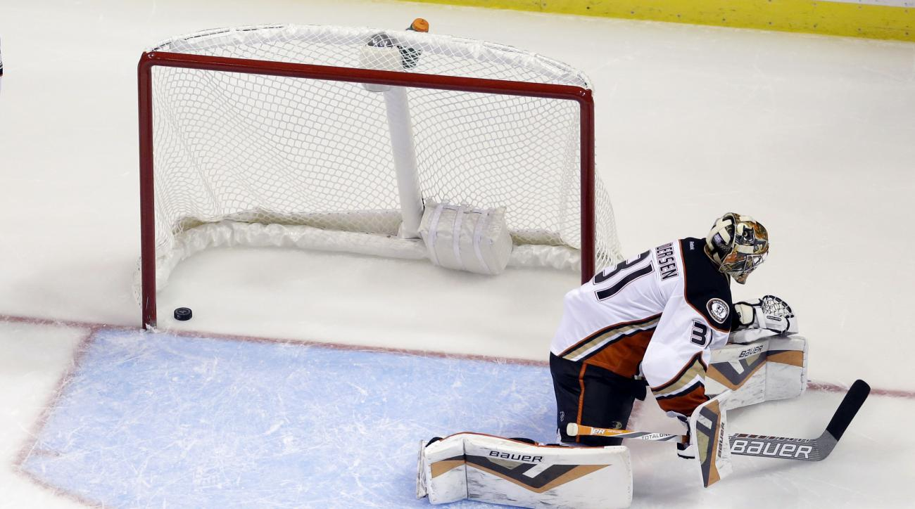 Anaheim Ducks goalie Frederik Andersen, of Denmark, pauses after a shot by St. Louis Blues' Colton Parayko rebounded off the boards and off his skate and into the net for a goal during the third period of an NHL hockey game Thursday, Oct. 29, 2015, in St.