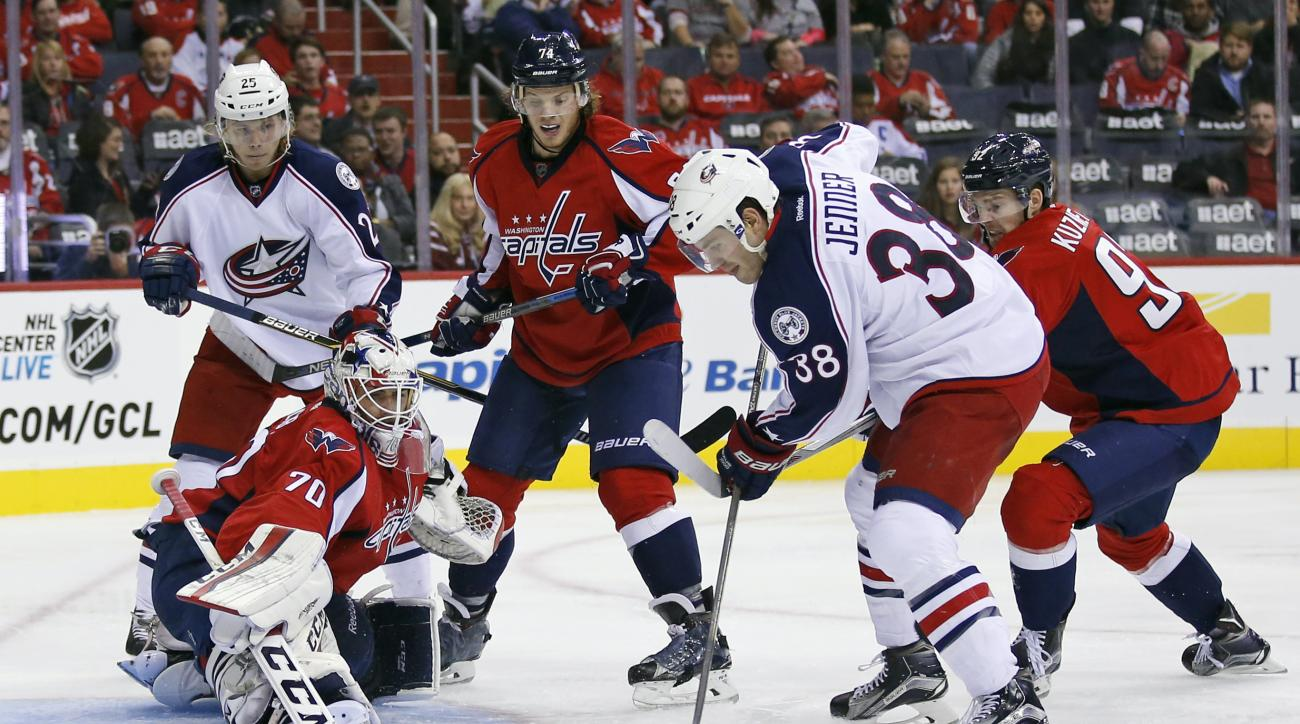 CORRECTS TO SECOND PERIOD NOT FIRST PERIOD - Washington Capitals goalie Braden Holtby (70) prepares to block a shot by Columbus Blue Jackets center Boone Jenner (38) with Blue Jackets center William Karlsson (25), from Sweden, Capitals defenseman John Car