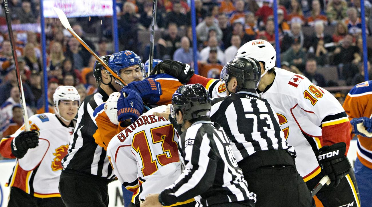 Calgary Flames and Edmonton Oilers mix it up during a scuffle in the first period of NHL action in Edmonton, Alberta, Saturday, Oct. 31, 2015. (Jason Franson/The Canadian Press via AP)