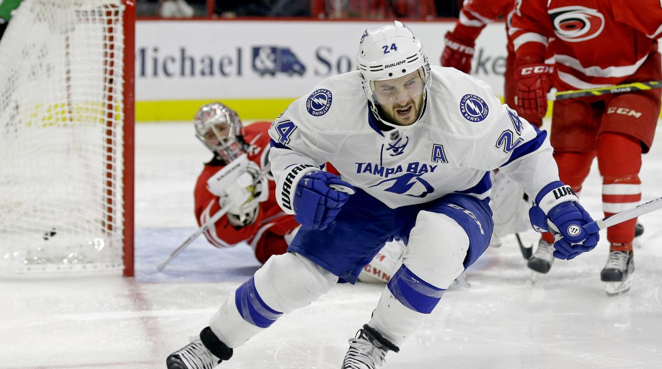Tampa Bay Lightning's Ryan Callahan (24) reacts as he scores on Carolina Hurricanes goalie Cam Ward during the second period of an NHL hockey game in Raleigh, N.C., Sunday, Nov. 1, 2015. (AP Photo/Gerry Broome)