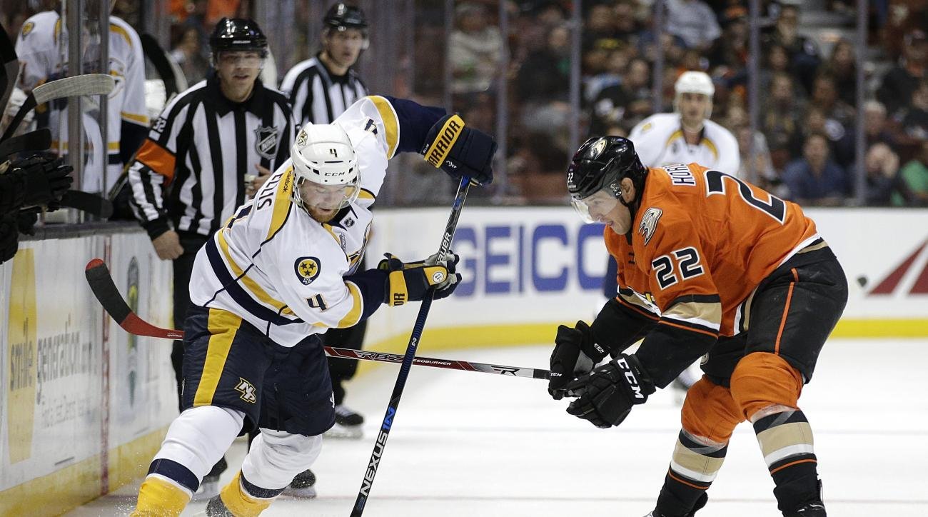 Nashville Predators' Ryan Ellis, left, is defended by Anaheim Ducks' Shawn Horcoff during the second period of an NHL hockey game, Sunday, Nov. 1, 2015, in Anaheim, Calif. (AP Photo/Jae C. Hong)