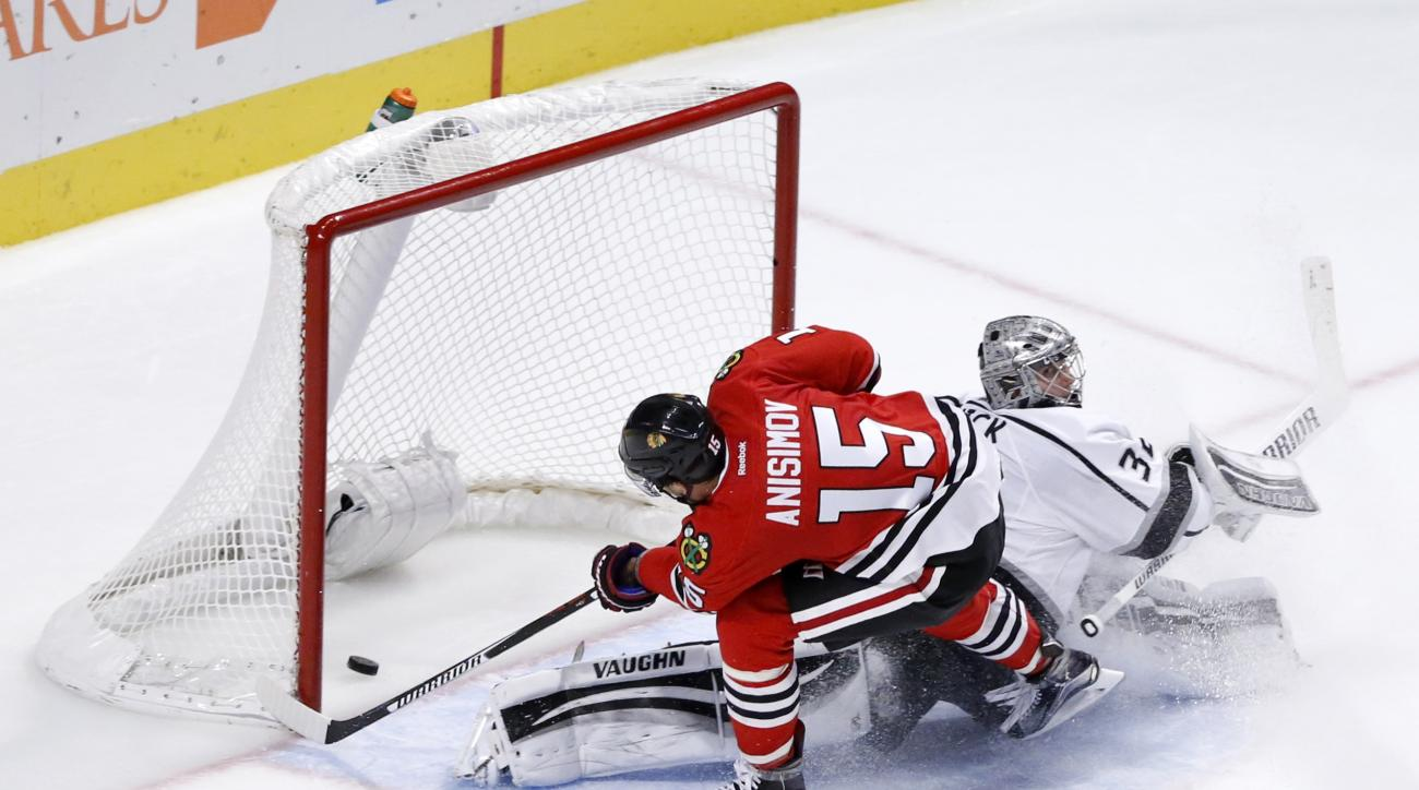 Chicago Blackhawks center Artem Anisimov (15) scores a shorthanded goal against Los Angeles Kings goalie Jonathan Quick during the third period of an NHL hockey game Monday, Nov. 2, 2015, in Chicago. The Blackhawks won 4-2. (AP Photo/Charles Rex Arbogast)