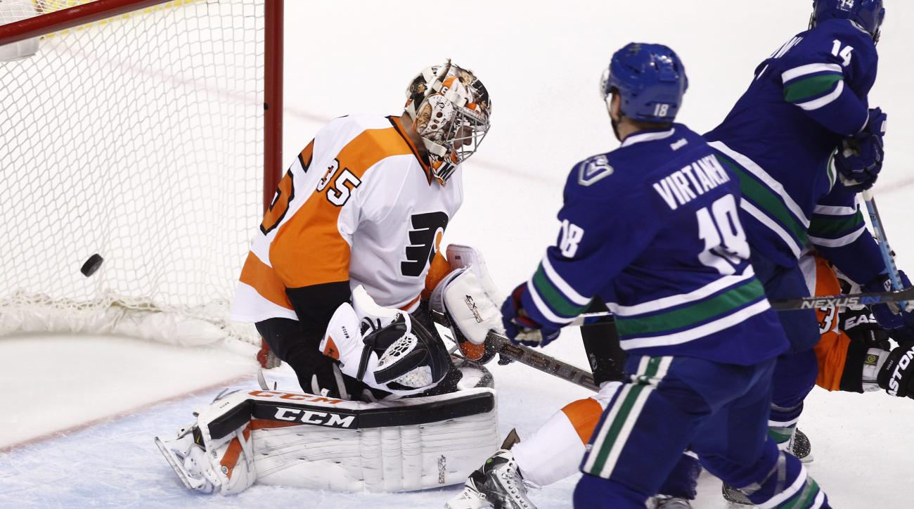 Vancouver Canucks Jake Virtanen (18) scores against Philadelphia Flyers goaltender Steve Mason during third period NHL hockey action in Vancouver, British Columbia, on Monday, Nov. 2, 2015. (Ben Nelms/The Canadian Press via AP)