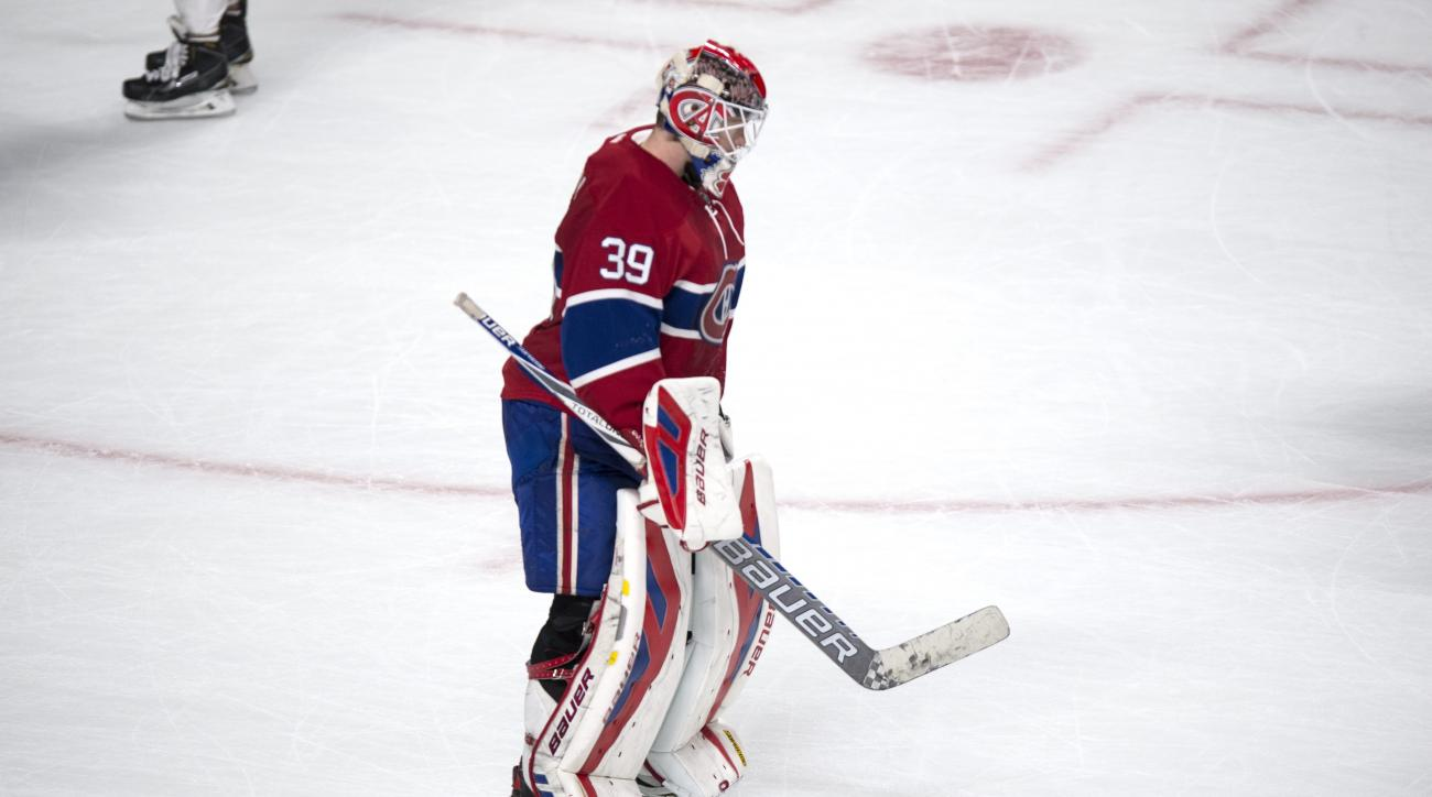 Montreal Canadiens goalie Mike Condon skates off the ice after allowing an overtime goal to Ottawa Senators' Kyle Turris during an NHL hockey game Tuesday, Nov. 3, 2015, in Montreal. The Senators won 2-1. (Paul Chiasson/The Canadian Press via AP)