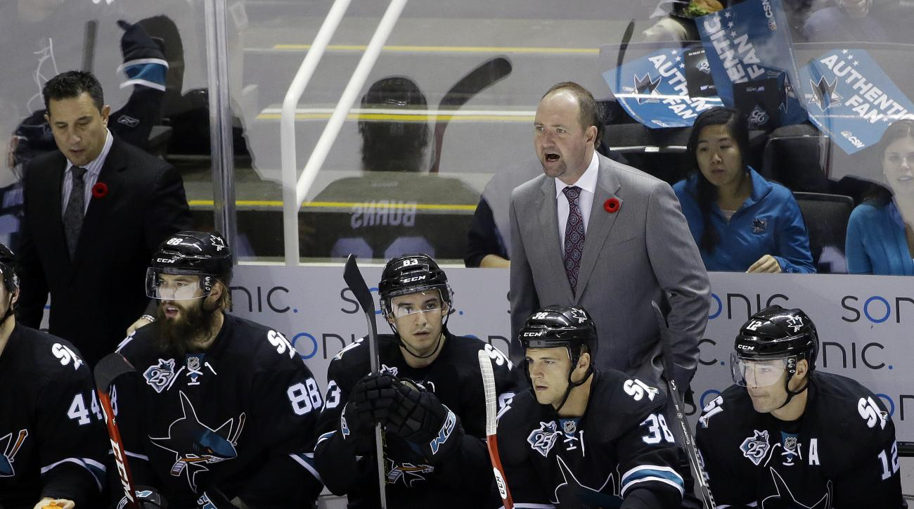 San Jose Sharks coach Peter DeBoer, top right, argues a call during the first period of an NHL hockey game against the Florida Panthers on Thursday, Nov. 5, 2015, in San Jose, Calif. (AP Photo/Marcio Jose Sanchez)