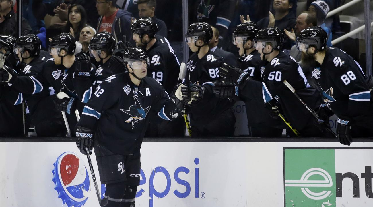 San Jose Sharks' Patrick Marleau (12) celebrates his goal with teammates on the bench during the second period of an NHL hockey game against the Florida Panthers on Thursday, Nov. 5, 2015, in San Jose, Calif. (AP Photo/Marcio Jose Sanchez)