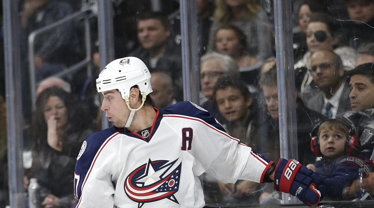 Columbus Blue Jackets' Brandon Dubinsky, left, collides with Los Angeles Kings' Andy Andreoff during the second period of an NHL hockey game, Thursday, Nov. 5, 2015, in Los Angeles. (AP Photo/Jae C. Hong)