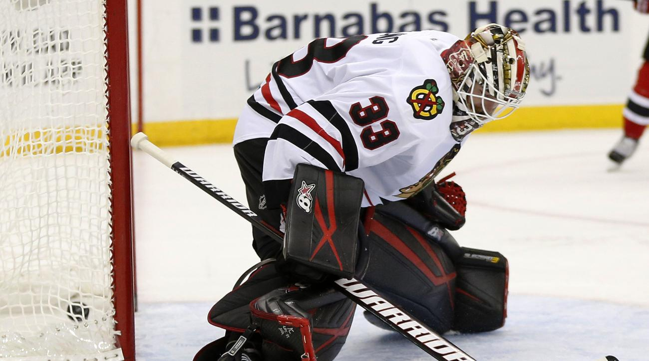 Chicago Blackhawks goalie Scott Darling is unable to stop a shot by New Jersey Devils left wing Mike Cammalleri during the second period of an NHL hockey game, Friday, Nov. 6, 2015, in Newark, N.J. (AP Photo/Julio Cortez)