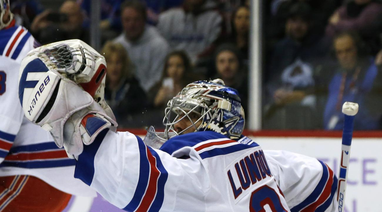 New York Rangers goalie Henrik Lundqvist, of Sweden, makes a glove-save of a shot by the Colorado Avalanche in the first period of an NHL hockey game Friday, Nov. 6, 2015, in Denver. (AP Photo/David Zalubowski)
