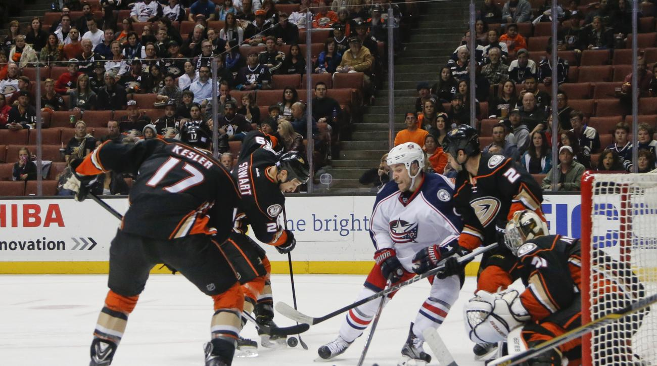 Columbus Blue Jackets center Gregory Campbell battles Anaheim Ducks center Ryan Kesler, left, and Kevin Bieksa, right, while trying to score against goalie Frederik Andersen during the first period of an NHL hockey game Friday, Nov. 6, 2015, Anaheim, Cali