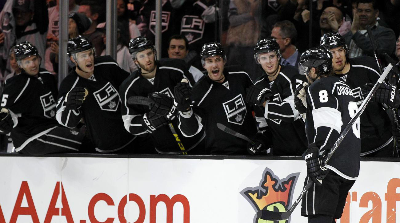 Los Angeles Kings defenseman Drew Doughty (8) celebrates with teammates on the bench after scoring against the Florida Panthers during the second period of an NHL hockey game in Los Angeles, Saturday, Nov. 7, 2015. (AP Photo/Alex Gallardo)
