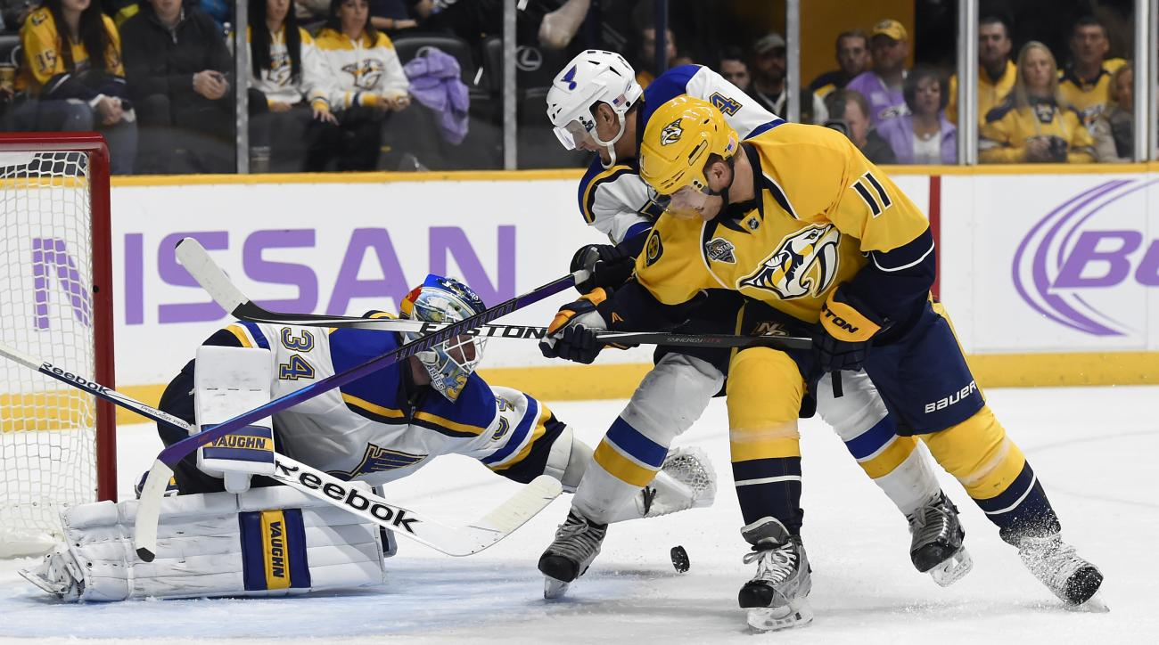 St. Louis Blues goalie Jake Allen (34) covers up the puck after a shot by Nashville Predators center Cody Hodgson (11) in the second period of an NHL hockey game, Saturday, Nov. 7, 2015, in Nashville, Tenn. Defending for  Blues is Carl Gunnarsson (4), of