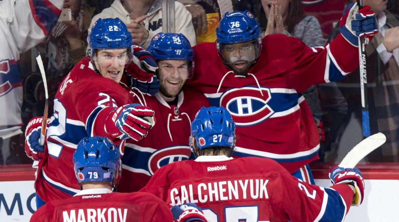 Montreal Canadiens' David Desharnais (51) celebrates his goal against the Boston Bruins with teammates, from left to right, Andrei Markov, Dale Weise, Alex Galchenyuk and P.K. Subban during third period NHL hockey action, in Montreal, on Saturday, Nov. 7,