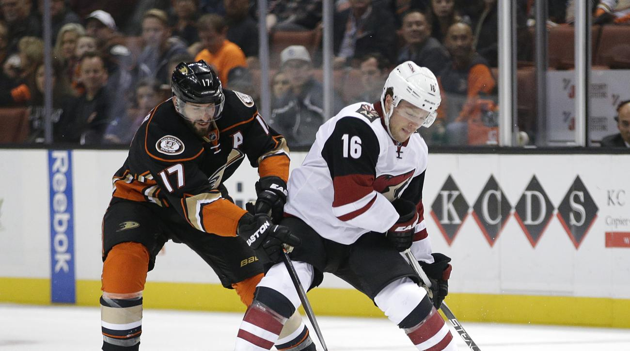 Arizona Coyotes' Max Domi, right, is defended by Anaheim Ducks' Ryan Kesler during the first period of an NHL hockey game, Monday, Nov. 9, 2015, in Anaheim, Calif. (AP Photo/Jae C. Hong)
