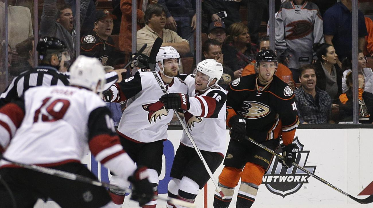 Arizona Coyotes' Mikkel Boedker, left, of Denmark, and Max Domi celebrate Boedker's  gaming winning goal in overtime of an NHL hockey game against the Anaheim Ducks, Monday, Nov. 9, 2015, in Anaheim, Calif. The Coyotes won 4-3 in overtime. (AP Photo/Jae C