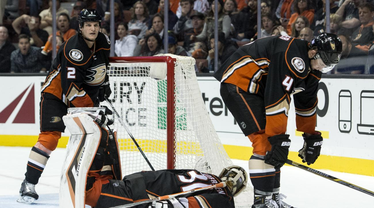 Anaheim Ducks' Cam Fowler, right, hangs his head after Arizona Coyotes' Max Domi, not shown, scores during a an NHL hockey game in Anaheim, Calif., Monday, Nov. 9, 201. 5 (Kyusung Gong/The Orange County Register via AP)   MAGS OUT; LOS ANGELES TIMES OUT;