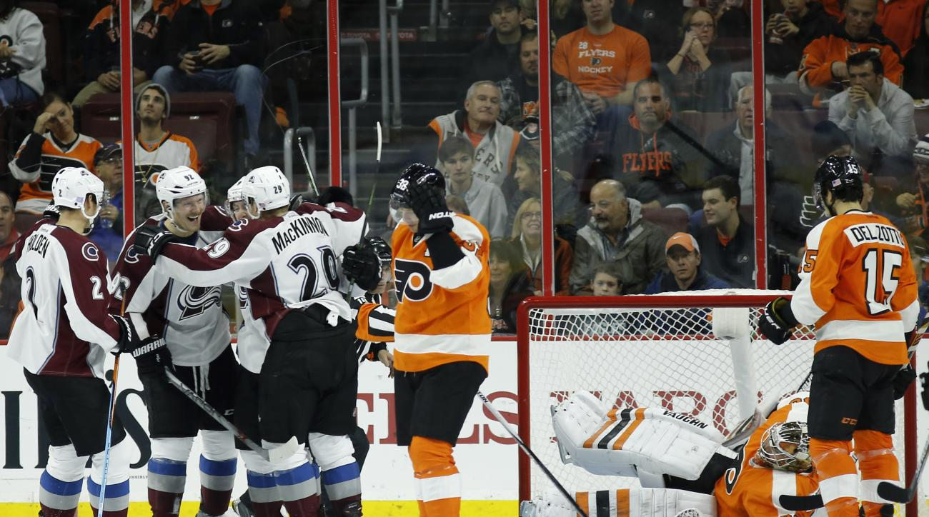 Colorado Avalanche players celebrate after a goal by Matt Duchene against Philadelphia Flyers' Michal Neuvirth during the second period of an NHL hockey game Tuesday, Nov. 10, 2015, in Philadelphia. (AP Photo/Matt Slocum)
