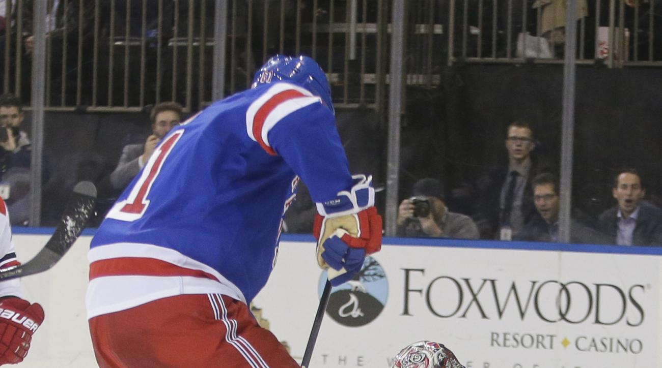 Carolina Hurricanes goalie Cam Ward (30) turns away a shot by New York Rangers' Rick Nash (61) during the second period of an NHL hockey game Tuesday, Nov. 10, 2015, in New York. (AP Photo/Frank Franklin II)
