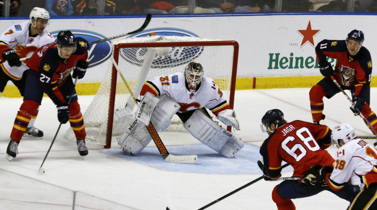 Florida Panthers right wing Jaromir Jagr (68) shoots to score the game-winning goal as Calgary Flames goalie Karri Ramo (31) defends in the third period of an NHL hockey game Tuesday, Nov. 10, 2015, in Sunrise, Fla. Florida won the game 4-3. (AP Photo/Joe