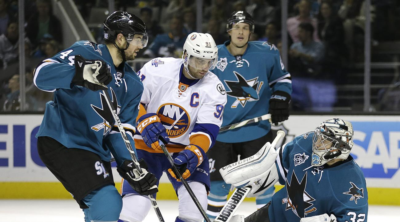 San Jose Sharks goalie Alex Stalock, right, and teammate Marc-Edouard Vlasic (44) defend New York Islanders' John Tavares (91) during the second period of an NHL hockey game Tuesday, Nov. 10, 2015, in San Jose, Calif. (AP Photo/Ben Margot)
