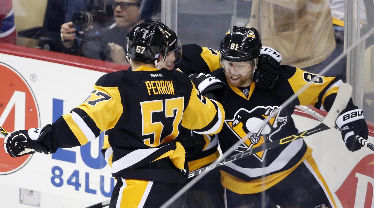Pittsburgh Penguins' Phil Kessel (81) celebrates his goal with teammates in the first period of an NHL hockey game against the Montreal Canadiens in Pittsburgh, Wednesday, Nov. 11, 2015.(AP Photo/Gene J. Puskar)