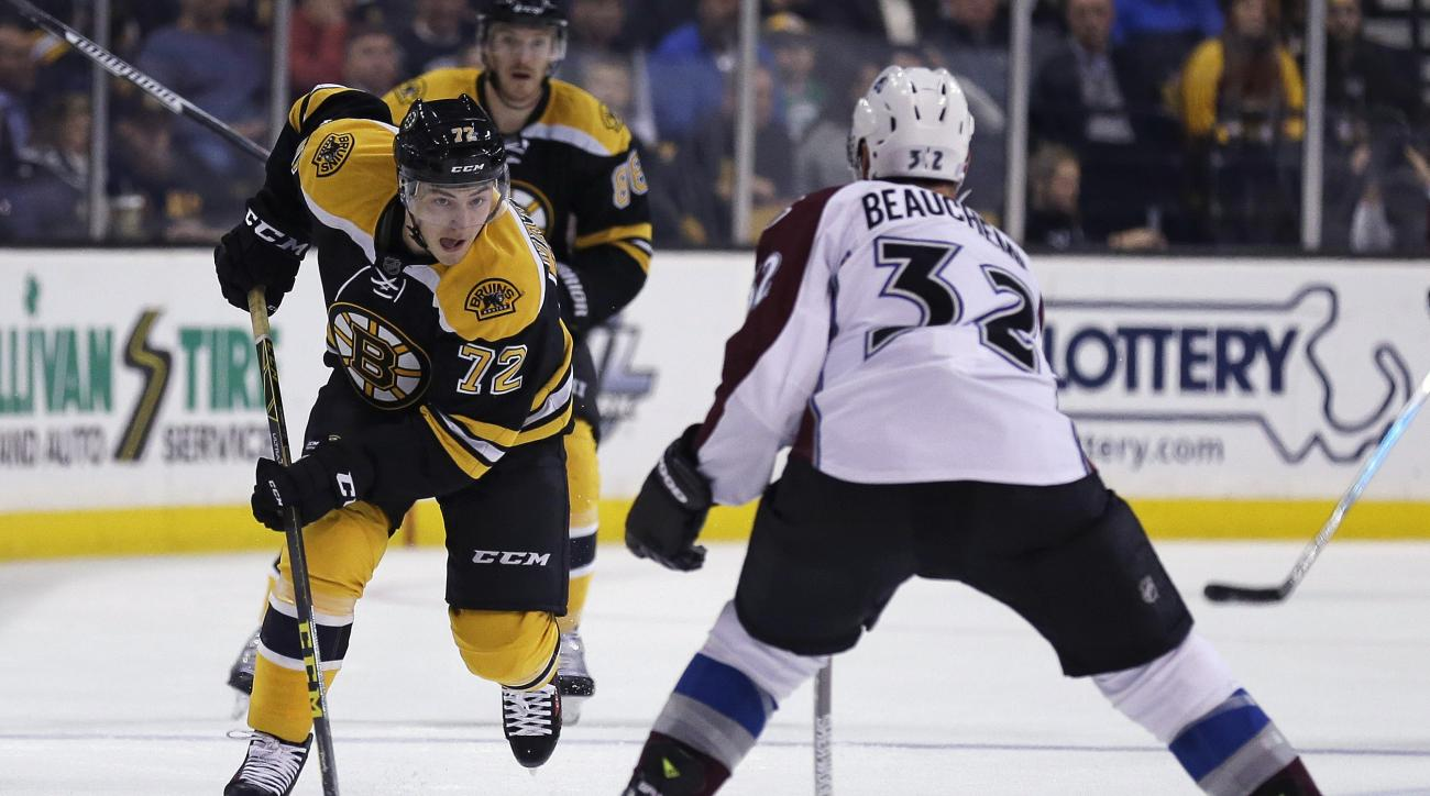 Boston Bruins center Frank Vatrano (72) tries to skate past Colorado Avalanche defenseman Francois Beauchemin (32) during the second period of an NHL hockey game in Boston, Thursday, Nov. 12, 2015. (AP Photo/Charles Krupa)