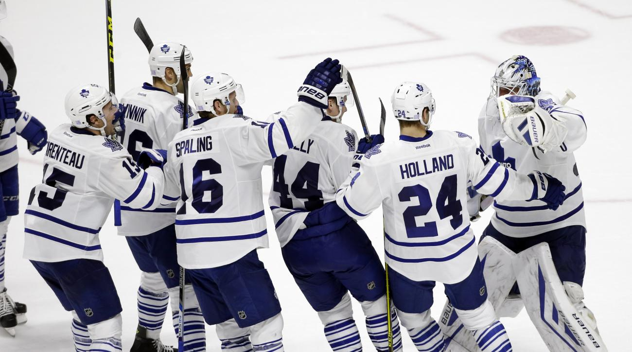 Toronto Maple Leafs players celebrate after Peter Holland (24) scored a goal against the Nashville Predators during a shootout at an NHL hockey game Thursday, Nov. 12, 2015, in Nashville, Tenn. The goal gave the Maple Leafs a 2-1 win. (AP Photo/Mark Humph