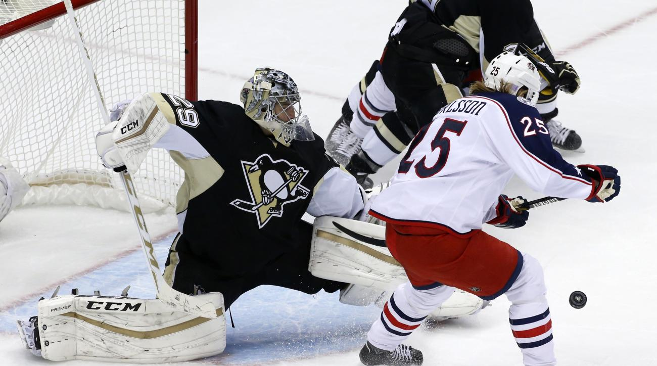 Pittsburgh Penguins goalie Marc-Andre Fleury (29) stops a shot by Columbus Blue Jackets' William Karlsson (25) during the first period of an NHL hockey game in Pittsburgh on Friday, Nov. 13, 2015. (AP Photo/Gene J. Puskar)
