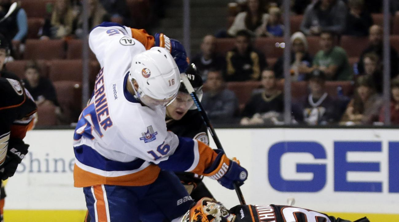 Anaheim Ducks goalie Anton Khudobin, right, blocks shot by New York Islanders right wing Steve Bernier during the first period of an NHL hockey game in Anaheim, Calif., Friday, Nov. 13, 2015. (AP Photo/Chris Carlson)