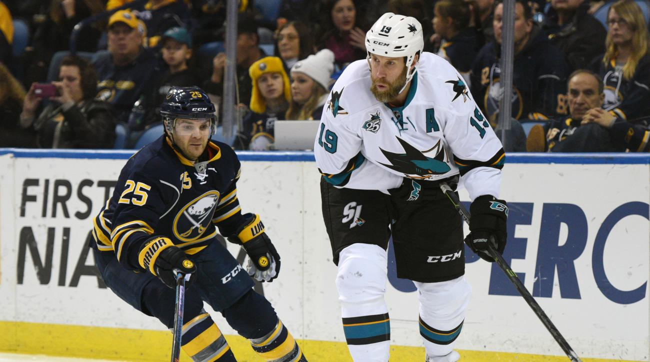Buffalo Sabres defenseman Carlo Colaiacovo (25) defends as San Jose Sharks center Joe Thornton (19) passes the puck during the second period of an NHL hockey game, Saturday Nov. 14, 2015 in Buffalo, N.Y. (AP Photo/Gary Wiepert)
