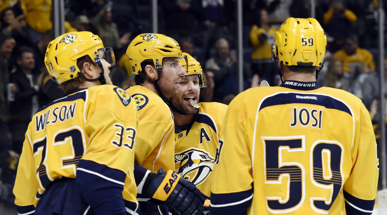 Nashville Predators right wing James Neal, second from left, celebrates with Colin Wilson (33), Mike Fisher, second from right, and Roman Josi (59), of Switzerland, after Neal scored a goal in the second period of an NHL hockey game against the Winnipeg J
