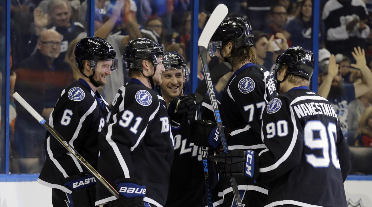 Tampa Bay Lightning center Vladislav Namestnikov (90), of Russia, celebrates his goal against the Florida Panthers with teammates, including defenseman Anton Stralman (6), of Sweden, center, Steven Stamkos (91), right wing Ryan Callahan (24) and defensema