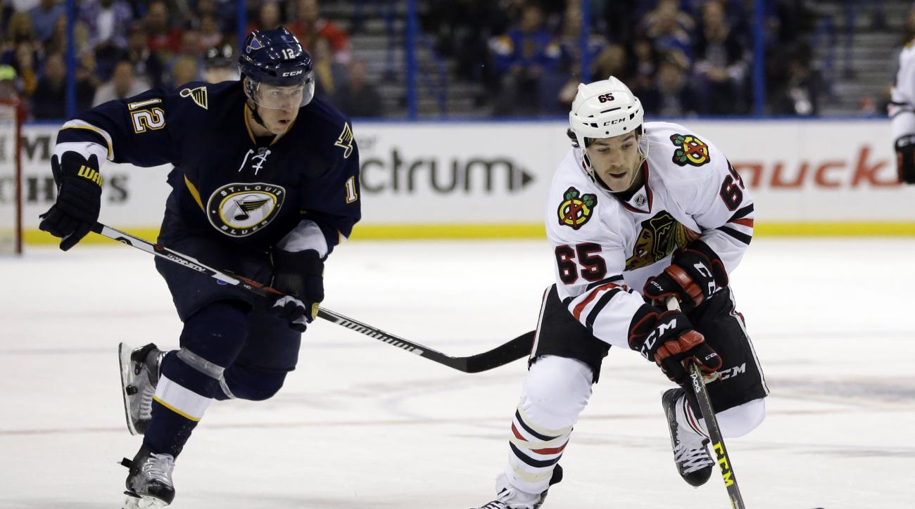 Chicago Blackhawks' Andrew Shaw, right, controls the puck as St. Louis Blues' Jori Lehtera, of Finland, gives chase during the third period of an NHL hockey game Saturday, Nov. 14, 2015, in St. Louis. The Blackhawks won 4-2. (AP Photo/Jeff Roberson)